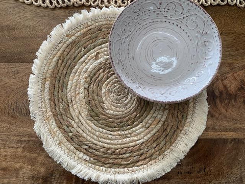 Woven fringed placemat