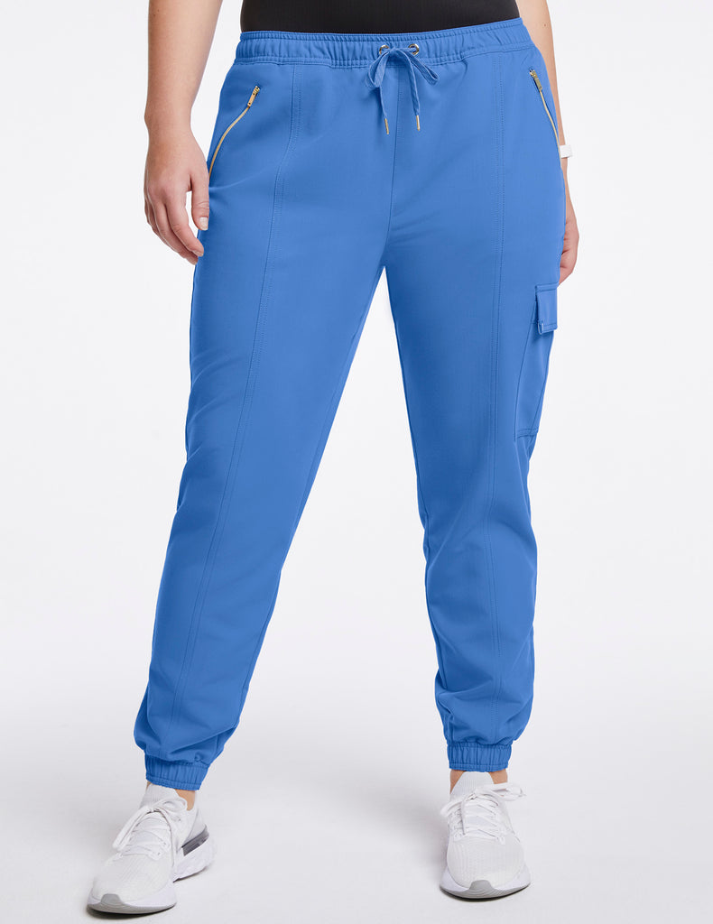 Jaanuu | Women's Essential Gold Zip Jogger - Ceil Blue - 1 - Curve