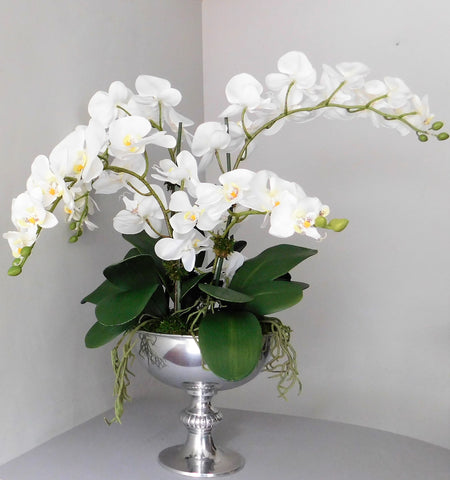 artificial white orchid in silver punchbowl