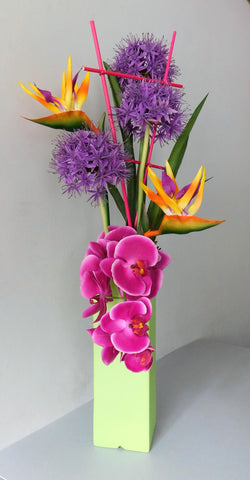 artificial tropical arrangement of alium,orchid and strelitzia