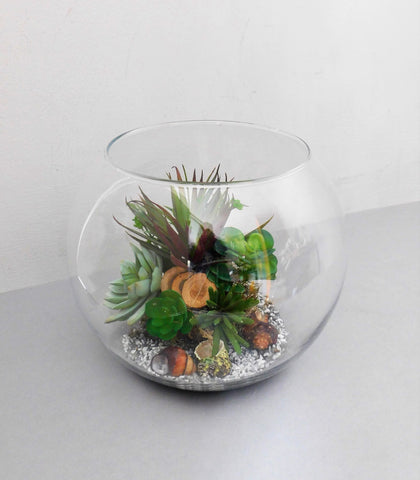 artificial succulents in a glass fishbowl