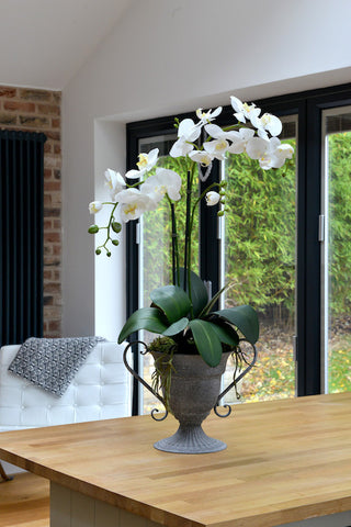 Sarah - Artificial white orchid arrangement in rustic urn