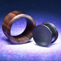 wooden flesh plugs and ear tunnels