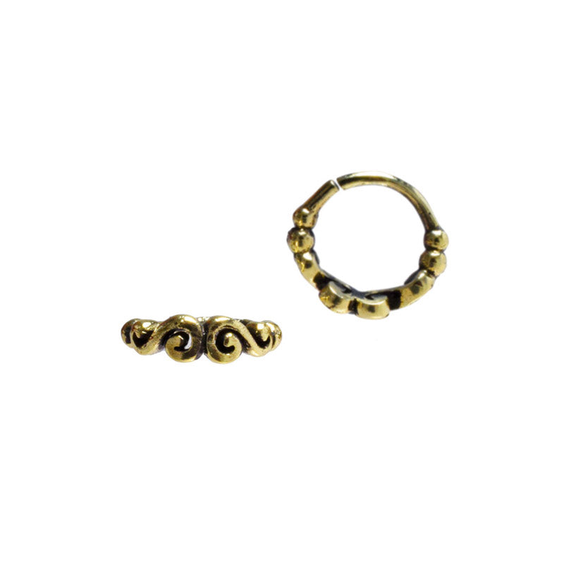 A Brass Nose Ring With A Double Spiral Design Arka