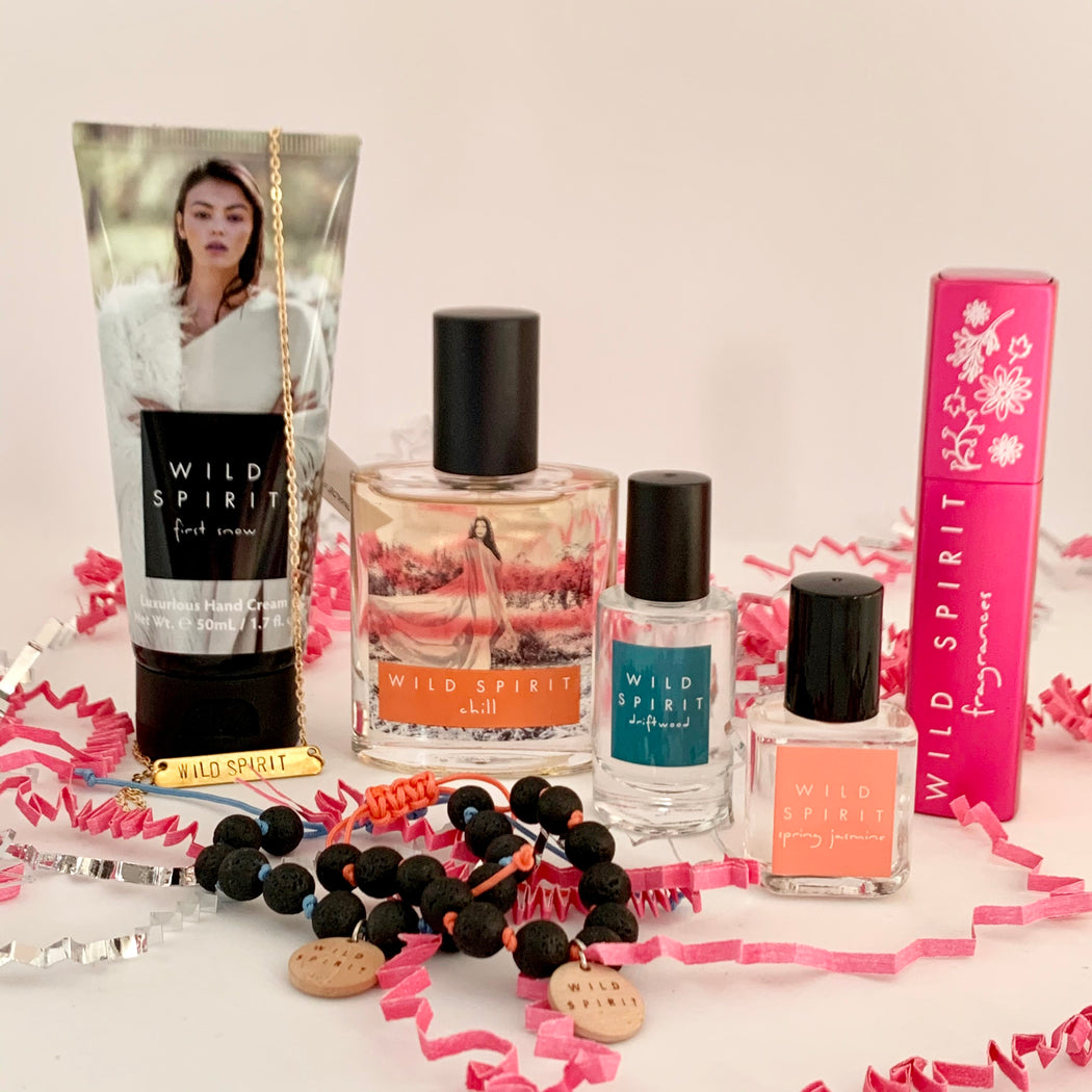 Whether a sweet, floral, fresh, or bold perfume lover, this kit has a little bit of everything and is full of mix and matching potential. Satisfy your sweet tooth with our best-selling Chill perfume, feel flirty on the go with a Rosy Glow Atomizer, keep hands moisturized with our First Snow Hand Cream, enjoy breezy florals with a Spring Jasmine Rollerball, stay fresh with a Driftwood Body Splash, and accessorize with our beautiful Wild Spirit Bar Necklace and two lava bead bracelets.