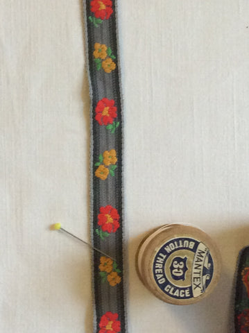 Vintage woven ribbon with orange and yellow flowers
