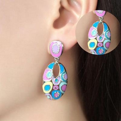 Funky sixties style enamel earrings, available in blue and pink or green and blue.