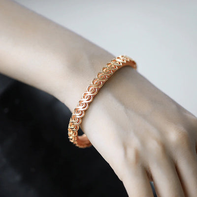 Hippolyta Stylized Woven Cuff Bangle - A beautiful and unusual rose gold bracelet.
