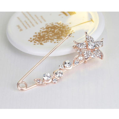 Scarf pins in assorted floral designs, rose gold colour with zircon crystals.