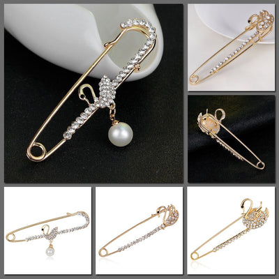 Scarf pins in assorted swan designs, gold colour with zircon crystals.