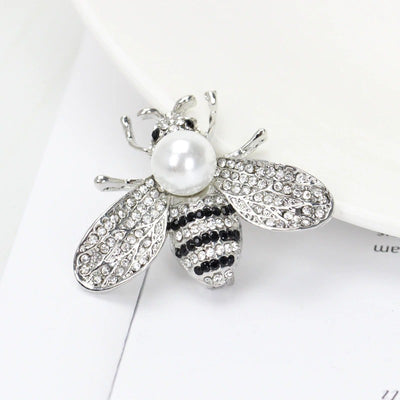 Queen Bee Brooch - A lovely rhinestone brooch shaped like a honeybee, and adorned with a large pearl. Available in gold or silver, with white or gold coloured pearls.