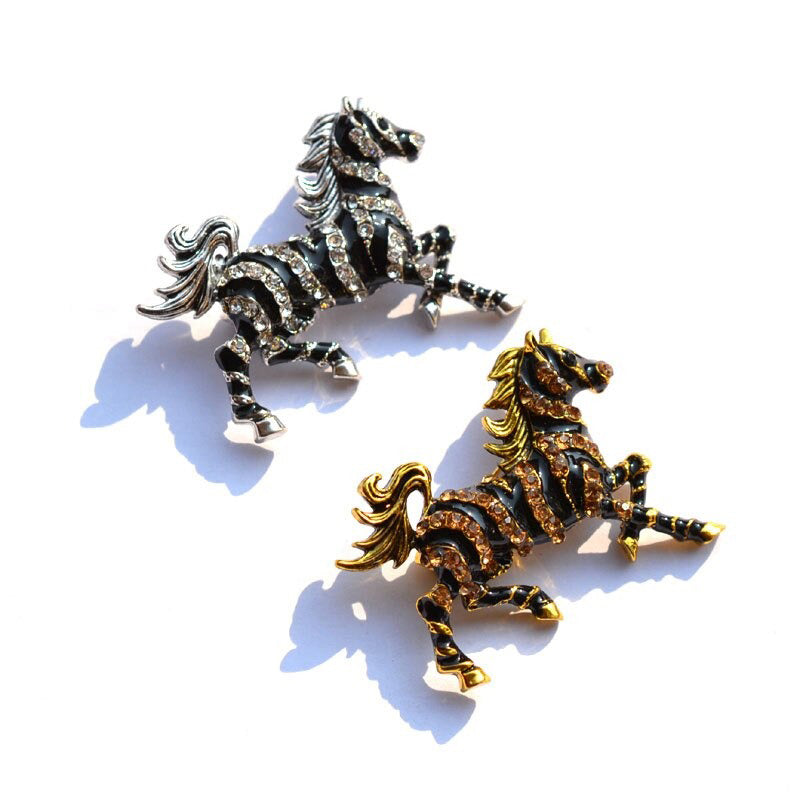 Zesty Zebra Brooch - A medium sized brooch shaped like a zebra running with its mane and tail flowing in the wind. It's available in gold or silver colours, and is studded with crystals.