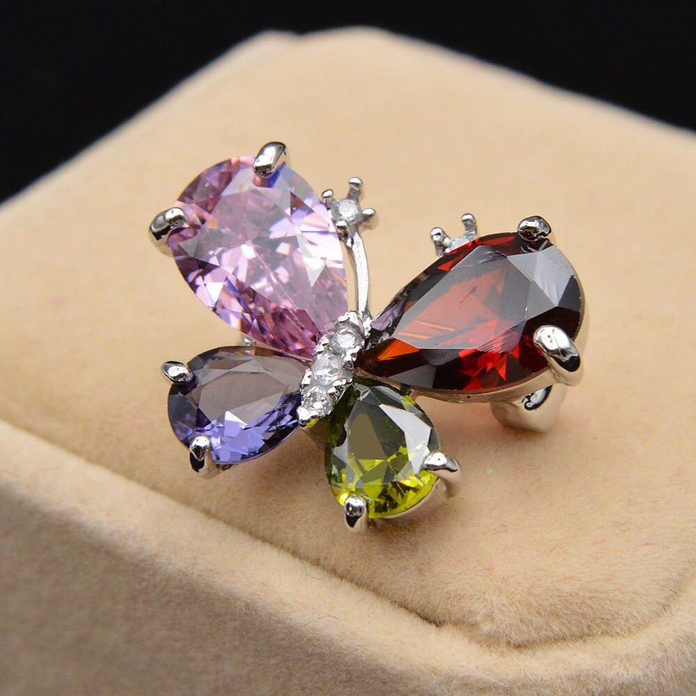 Bijoux Single Butterfly Brooch - A tiny, delicate little butterfly brooch made of shiny crystals.