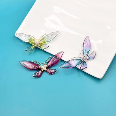 Magnifique Butterfly Brooch - A large, elegant resin brooch adorned with glitter and crystals, available in three lovely translucent colour palettes.