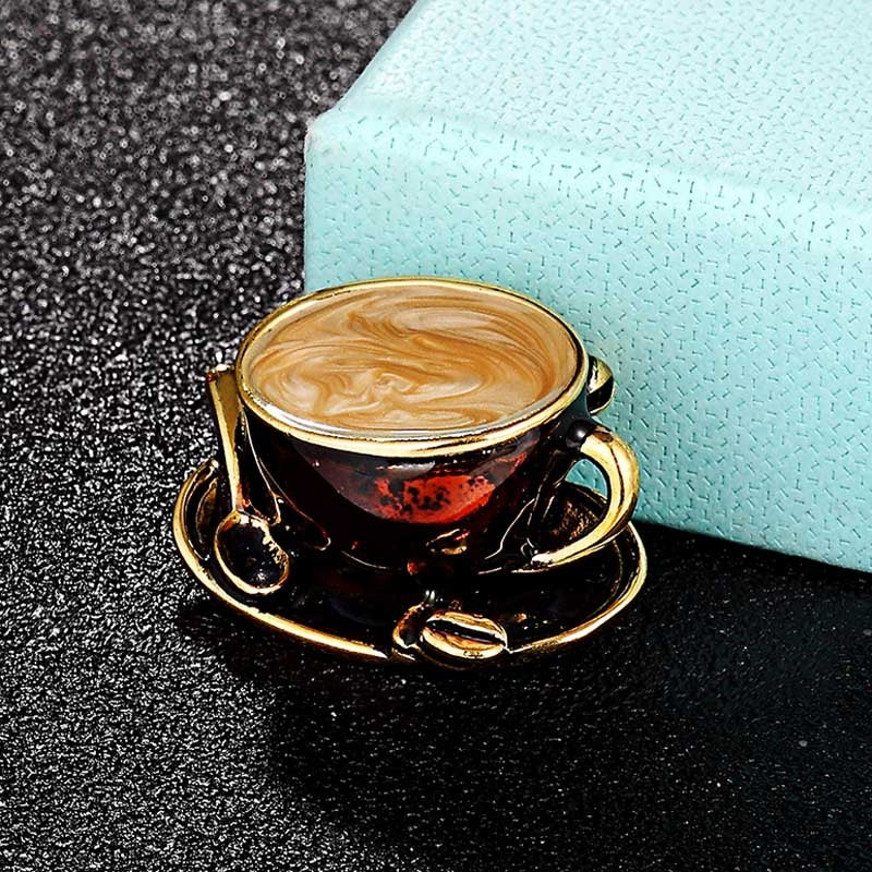 Lovely Latte Brooch - A small brooch that looks like a cup of steaming hot coffee in a cappuccino mug.