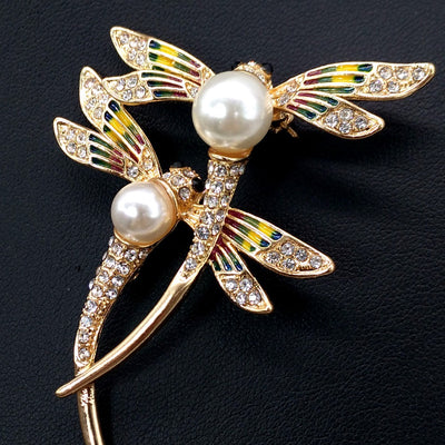 Dragonfly Duet Brooch - A lovely brooch featuring two crystal-encrusted dragonflies dancing in an imaginary breeze.