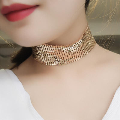 The Diva Drape Choker - A simple close-fitting necklace made of metal sequin mesh, available in gold, silver, or obsidian (black), and available in ether 25mm tall or 40mm tall.