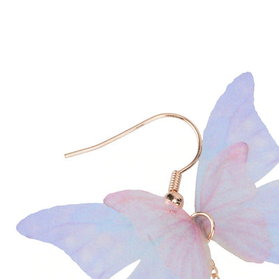 The Lilac Flutter Earrings - Delicate purple fabric butterfly earrings with long crystal tails.