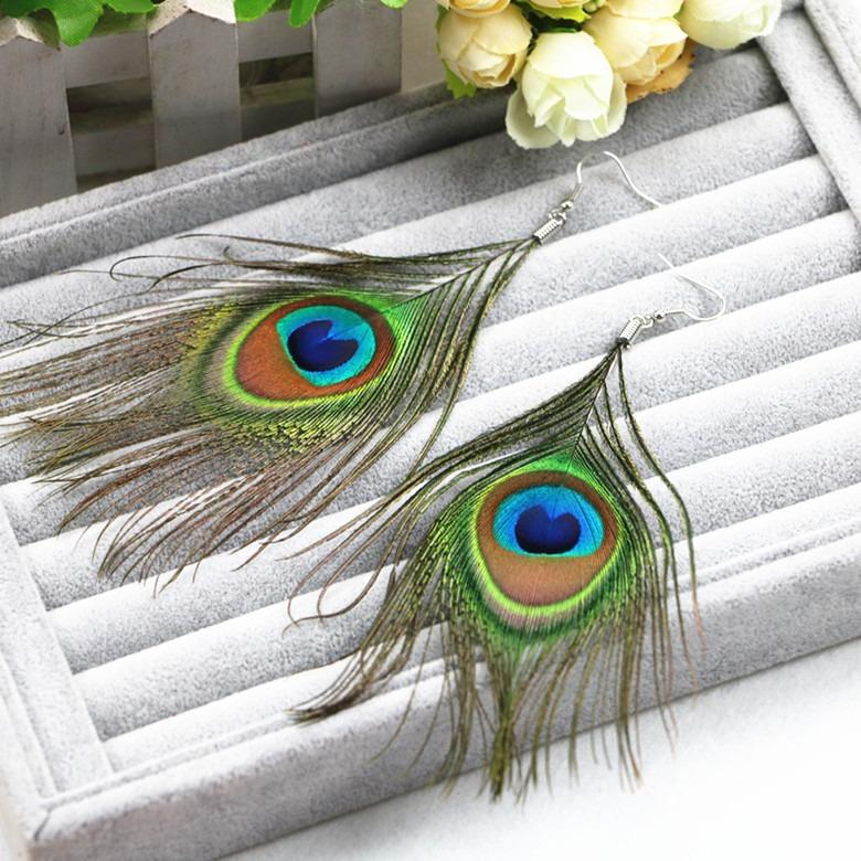 Large, elegant peacock feather earrings.