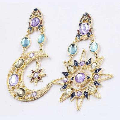 The Hypatia Earrings - A large, gold-coloured pair of earrings studded with artificial crystals, in a beautiful star and moon motif.