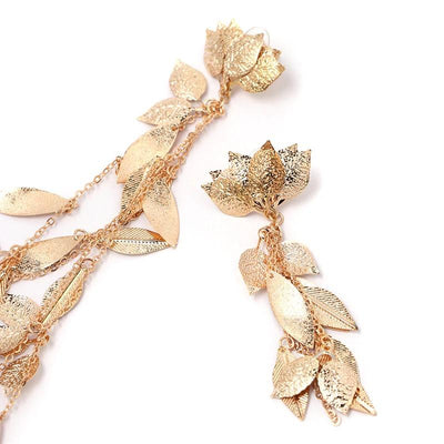 The Naomi Asymmetrical Vine Earrings - Long leaf-themed earrings available in gold or silver toned zinc alloy, with adjustable leaf charms.