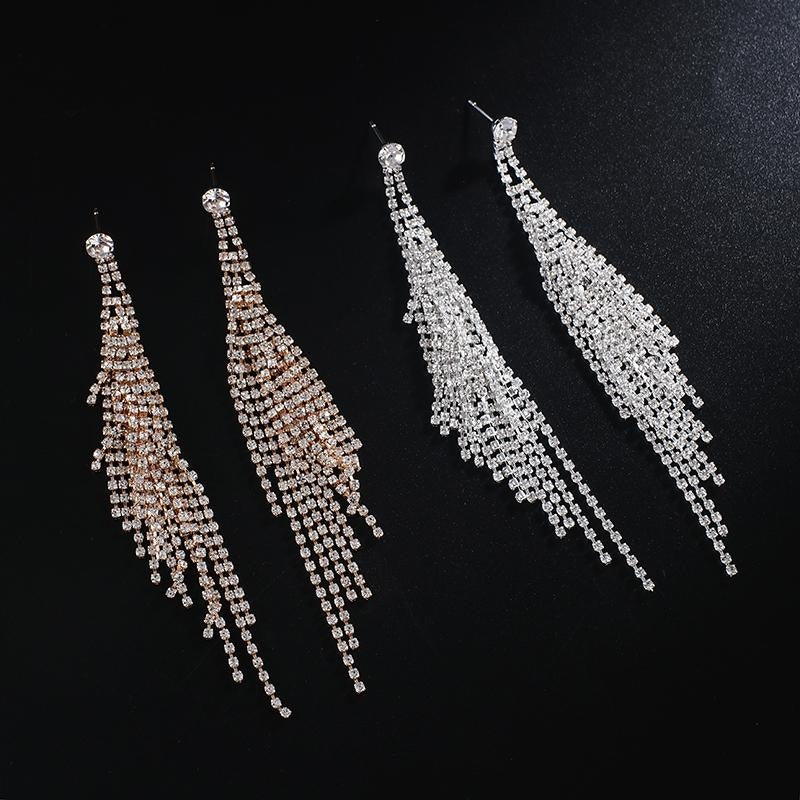The Elisa Luxury Crystal Earrings are the perfect start to your luxurious collection. They feature a larger crystal at the lobe, attached to multiple long, cascading strands to dance around your shoulders.