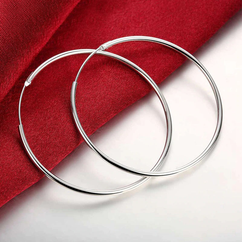 Essentials 925 Sterling Silver Hoop Earrings - Beautiful sterling silver hoop earrings, available in your choice of sizes.  Available in:  10mm, 15mm, 20mm, 30mm, 40mm, 50mm, and 70mm. Snag a shiny silver bargain!