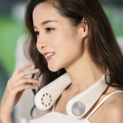 Breath of Fresh Air Hands-Free USB Neck Fan - A compact, slim-line fan that looks like a pair of fancy headphones, available in pink or white with shiny chrome accents.