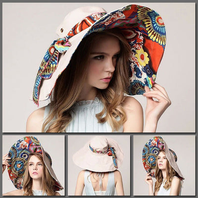 The Beach Bunny Reversible Sunhat - A large brimmed summer hat in vibrant shades of pink, blue, orange, salmon, cream, and khaki with paisley and floral prints.