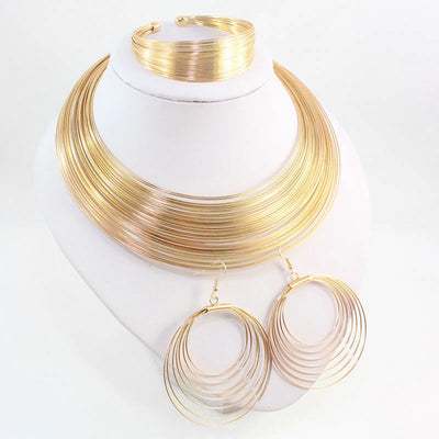 Aminatu Multi-Strand Torque Set II - A beautiful jewellery set made of narrow strands of gold-plated wire. Contains torque-style necklace, bracelet, and large circular earrings.