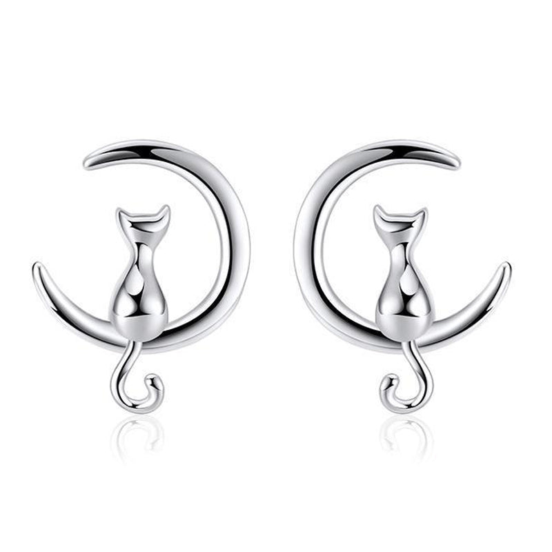 Moonlight Meowl Set - A delicate sterling silver jewellery set featuring a tiny kitty sitting on a crescent moon.