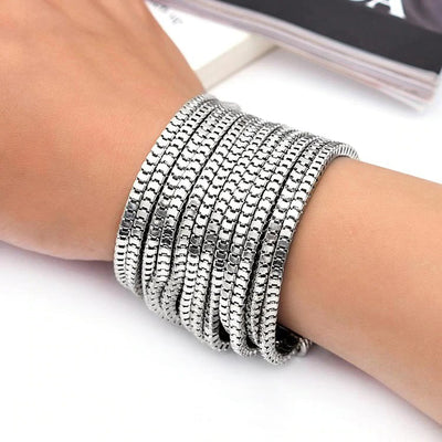 Elektra's Embrace Magnetic Clasp Bracelet - 12 Strand - A beautiful bracelet made up of multiple metal stands connected by a strong magnetic clasp.