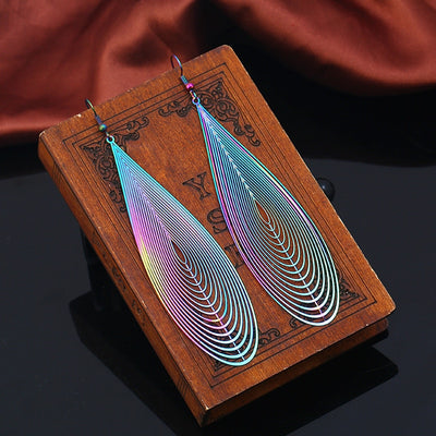 The Dazzle Collection - Droptastic - UV treated stainless steel earrings that glow in a rainbow of colours.