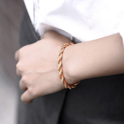 Damodice Spiral Chain Bracelet - A beautiful rose gold spiral chain bracelet that looks like it's made out of twisted strands of gold.