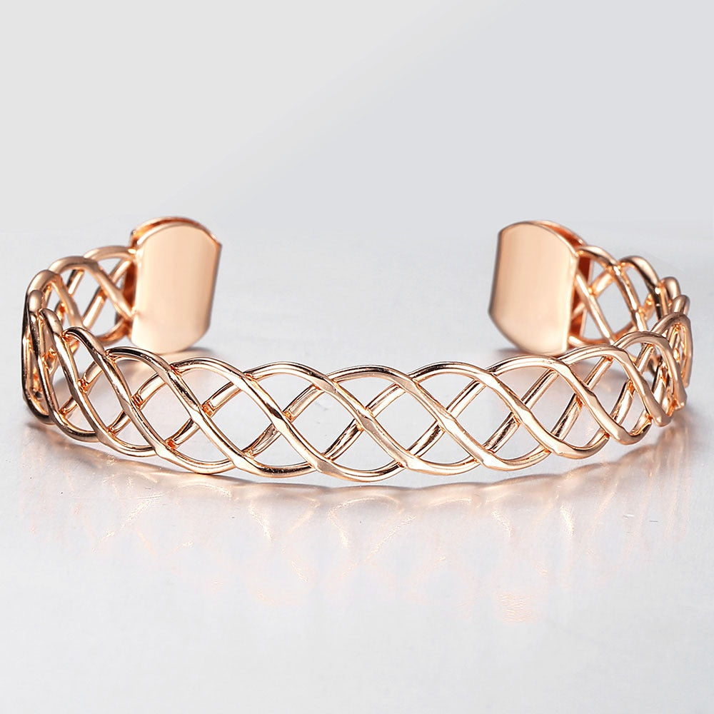 Celeste Woven Cuff Bracelet - A beautiful simple rose gold cuff that looks like plaited strands of wire.