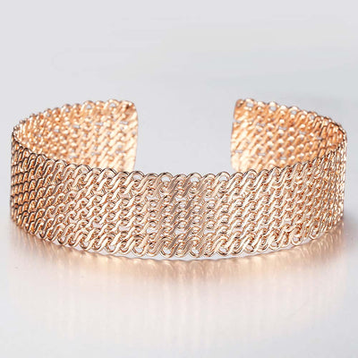 Petrina Woven Cuff Bracelet - A beautiful rose gold bangle that looks like it's made out of plaited or braided strands of gold.