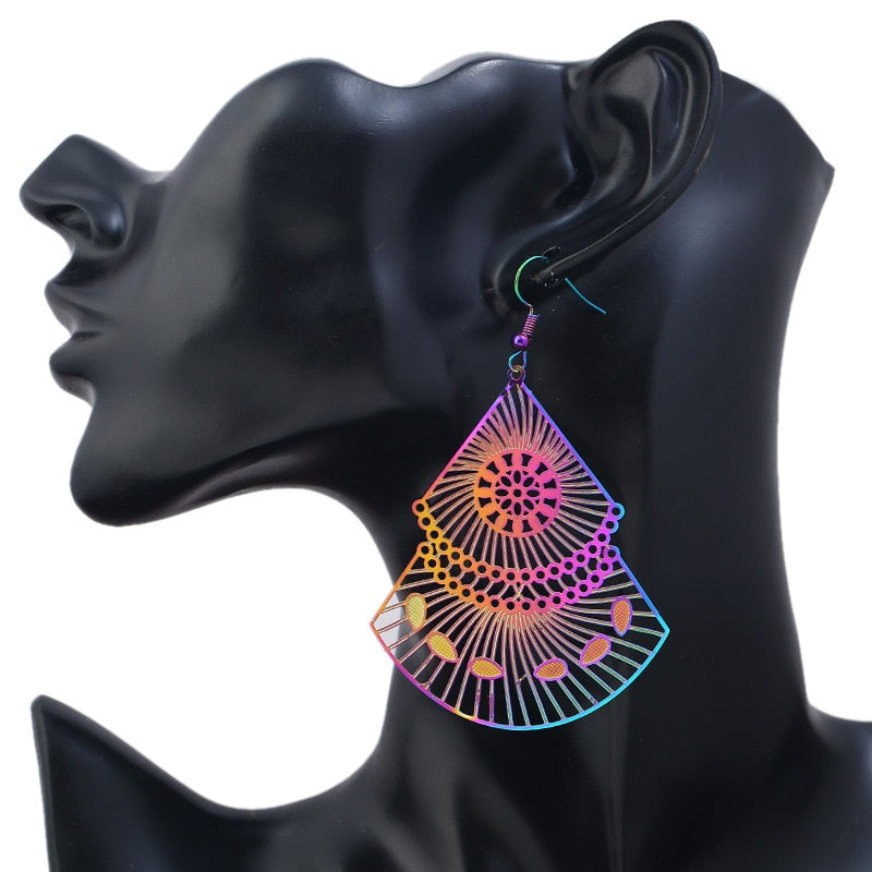 The Dazzle Collection - Tamyra - UV treated stainless steel earrings that glow in a rainbow of colours.