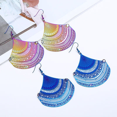 The Dazzle Collection - Sanjita - UV treated stainless steel earrings that glow in a rainbow of colours.