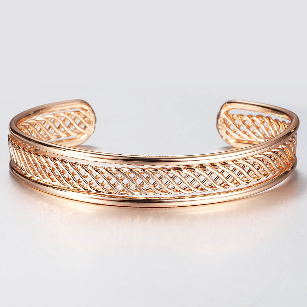 Alicia Woven Cuff Bracelet - A beautiful rose gold bangle that looks like it's made out of plaited or braided strands of gold.