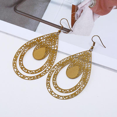 Curvaceous and stylish, the Anika Earrings are the perfect way to bring life and colour to a bland outfit. These huge drop earrings feature a combination of different sized droplets nestled within one another, with spots of texture to add contrast to the shiny surface.