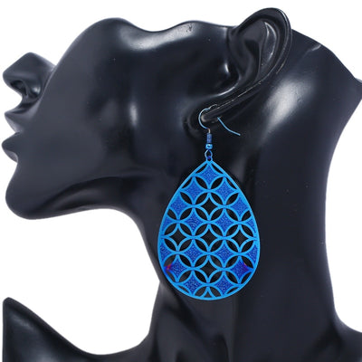 Add some geometric flair to your favourite outfit with the Maya Earrings!  These beauties feature a droplet-shaped outer edge, filled in by an intricate layer of interwoven circles and diamonds. Fascinating!