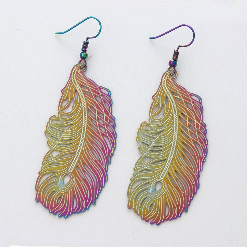 Love feathers, but allergic to the dander? Or maybe you just don't like the feel of feathers brushing against your skin? Well, the Nikita Earrings are here to help! These beautiful stainless steel earrings are made to resemble feathers, but they are very much still made of solid metal. Beautiful!