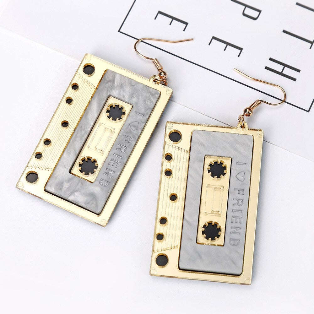 Teenytopia Rockin' Remix Earrings - Cute cassette tape earrings available in gold, pink, or purple.