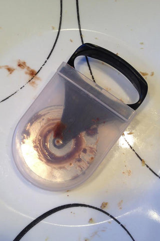 The Quick Spit® case closed - keeps that mess contained until you get home!
