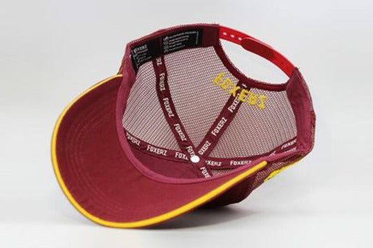 Number 10 cap maroon overturned view