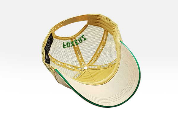 Foxerz's beige & green emblem of Saudi Arabia cap overturned