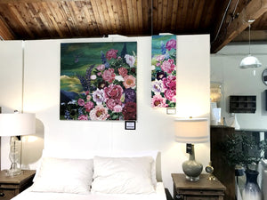 painting of flowers hanging above bed