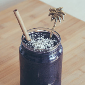 Sipeco Bamboo straw used in a purple smoothie with coconut shards as an eco-friendly alternative to single use plastic straws