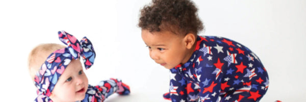 two kids wearing patriotic one piece baby clothing