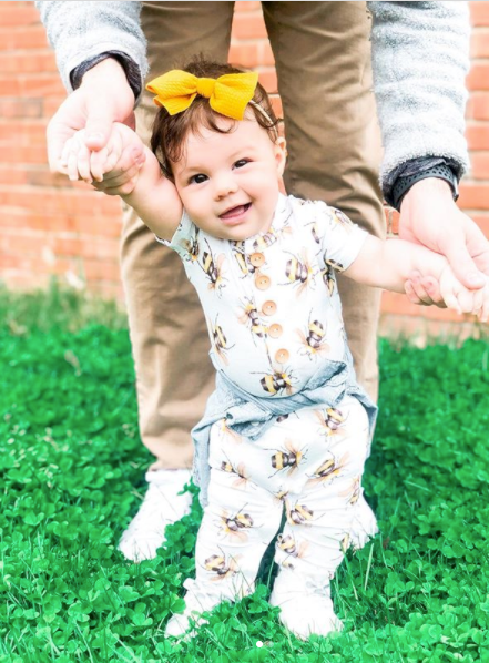 toddler wearing cute baby onesie with bee pattern by Posh Peanut